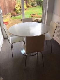 White kitchen table and four chairs