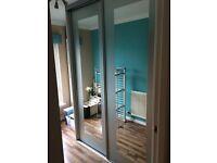 Double wardrobe - Mirrored. Floor to ceiling sliding doors