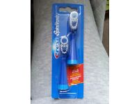 2 toothbrushes