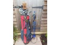Set of golf clubs. Old style but includes 3 woods, one of which is a Taylor Made, all irons and bag