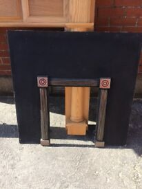 Fire surround and iron insert