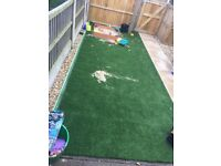 Artificial grass and sandpit