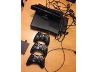 Xbox360 slim 4GB with 3 controllers, hdmi cable, 320GB removable hard drive, 11 games