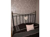 Double divan bed with black iron head board