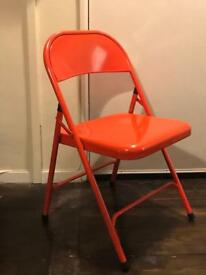 2 habitat chairs, green and red
