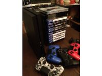ps4 1gb games bundle with storage unit and 3 playstation controllers.