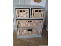 Shabby chic painted small storage unit. Sage green with wicker drawers. Handy for kitchen/bathroom