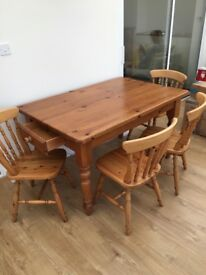 Farmhouse style Table. 4 chairs with spindle design backs. £100.0 o.n.o.