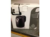 A brand new toaster and matching kettle