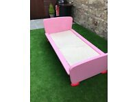 Kids Ikea pink bed and mattress.