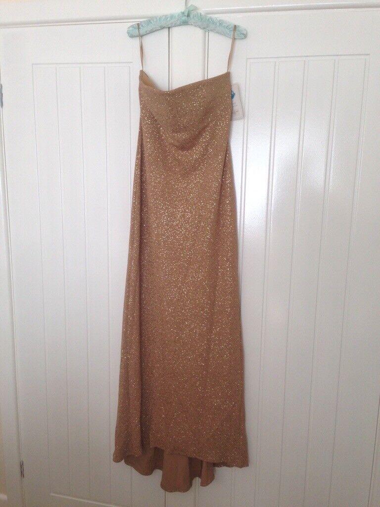Full length gold strapless evening dress never been worn