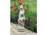 Assortment of garden statutes