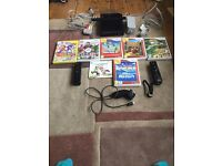Boxed Nintendo Wii console in Black (Mario Kart Wii pack).