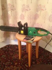 Electric chain saw for sale.