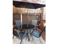 Round patio glass table and chairs