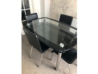 Glass table and chairs. Excellent condition.