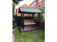 Burnt wood swing shelter , gazebo , decking , swings