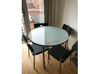 Round glass dinning table and chairs
