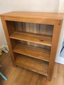 Solid light oak bookshelf.