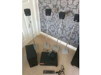 LG home cinema player with speakers, subwoofer and speaker stands