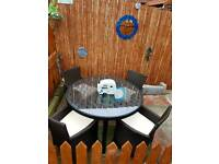 Rattan Table and 4 Chairs Excellent Condition