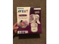 Electric and manual breast pump and bottles