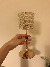 2 gold hurricane candle holders and 1 silver tealight holder