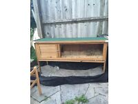 4 1/2 foot brand new rabbit hutch for sale, no rabbit has been in it