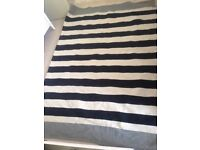 2 large striped rugs