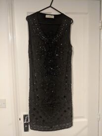Black dress with bead detailing - size 10
