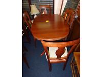 cherry wood table and 4 chairs by caxton furniture