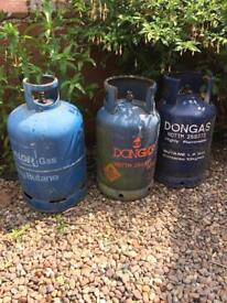 Empty Calor gas and don gas butane bottles for upcycling to burners