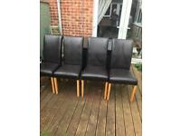 4 brown leather chairs.