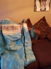 Two sets of teal curtains an tie backs size is 72 by 72 great condition
