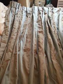 Blue and beige lined curtains