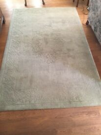 Green embossed rug. Good condition. Size 152.5cm x. 242.5cm