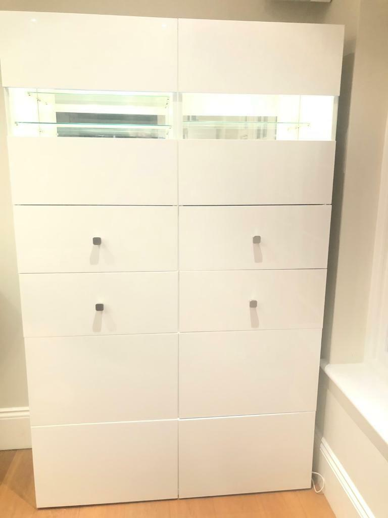 Tall white ikea cabinet with lights