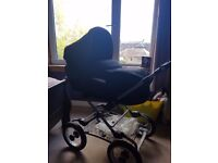 Silvercross pram with cosy toes, rain cover and umbrella