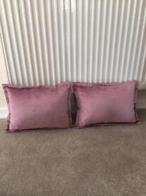 Mauve colour cushions and bedspread