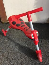 Kids scuttlebug scooter ride on