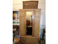 Antique pine wardrobe with bevelled mirror on the front