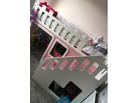 Single white and pink bed with stairs
