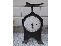 """Antique working black cast iron weighing scales, enamel face, weighs up to 25 lbs, 12"""" tall"""