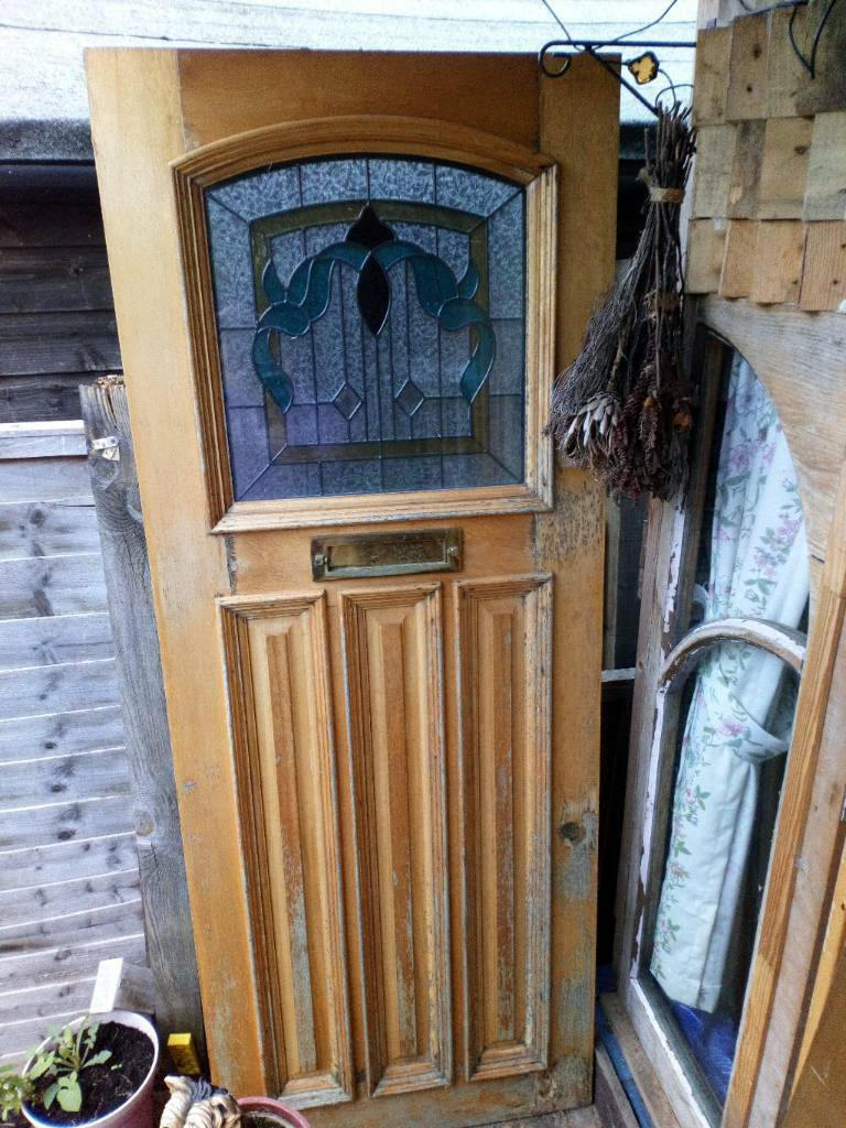 Solid Exterior Front Door With Stained Glass Panel Offers Welcome