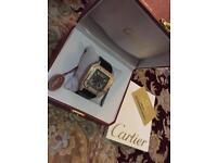 Rose gold Cartier watch xl santos 100
