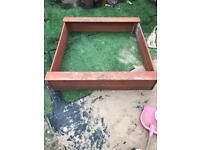 Plum wooden sand pit