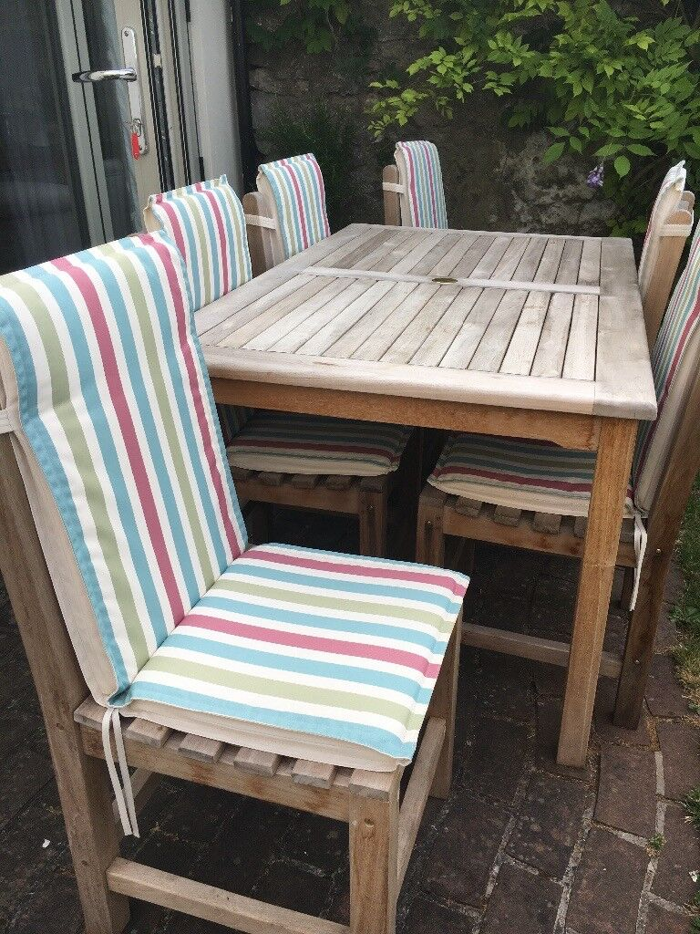 Teak set of 6 garden chairs solid construction and heavy high back padded seat covers redland