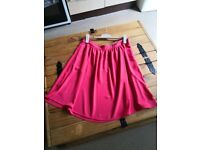 Red knee length flared skirt by TU, Size 12- 14. £3
