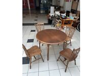 Round wooden table plus 4 chairs
