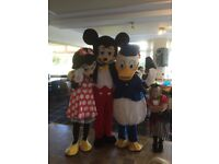 Assorted mascot style costumes . Mickey And Minnie Mouse, Donald and Daisy Duck